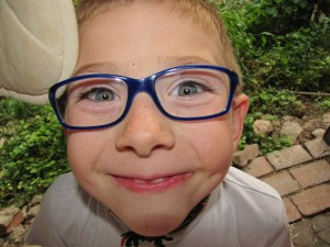 kid glasses smiling