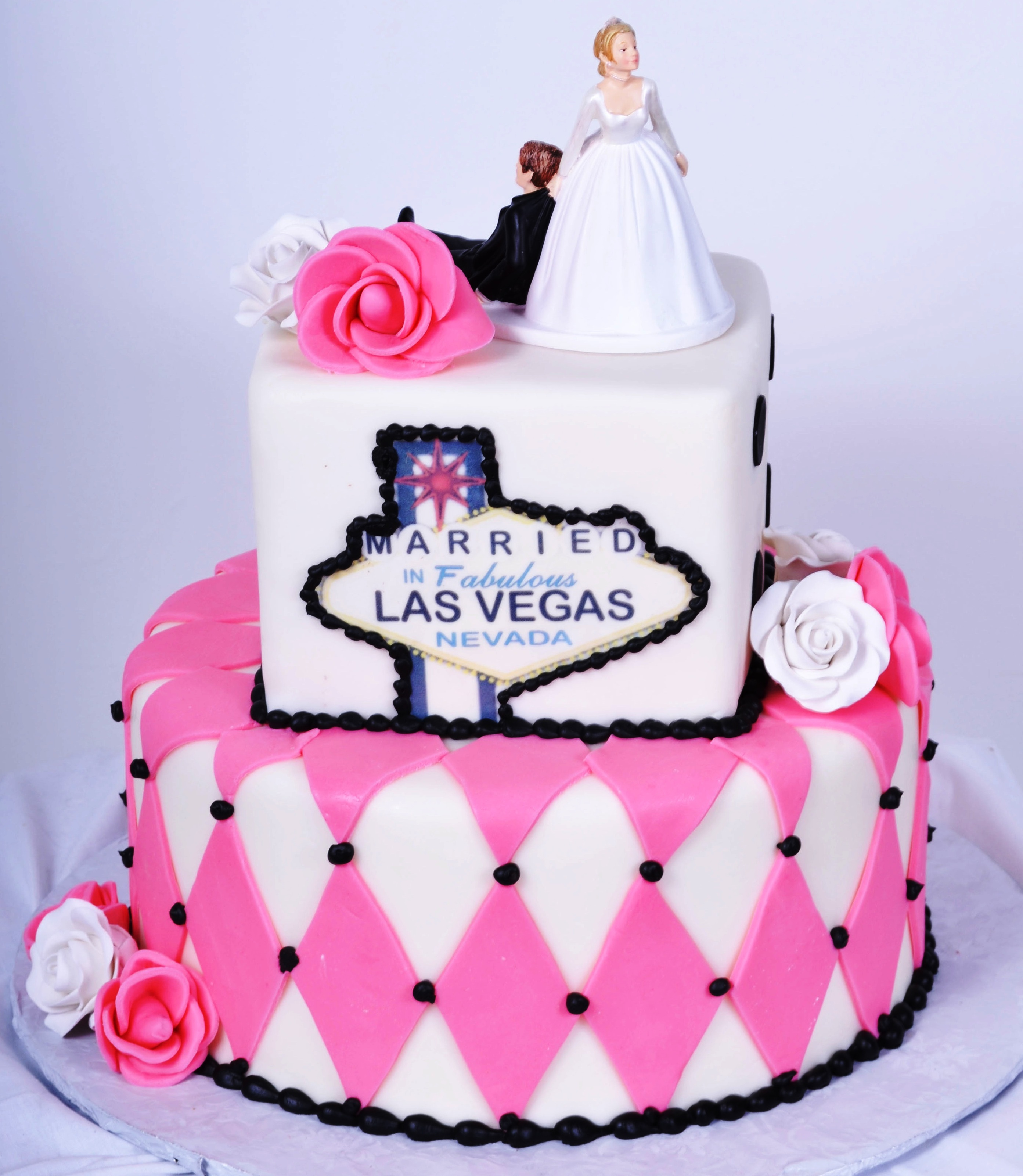 bride on a budget cheap wedding cakes Vegas theme wedding cake with pink