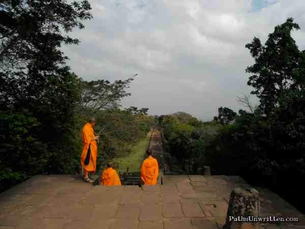 Contrast  Straddling the Cambodia border, atop of the extinct volcano of Phanom Rung, is one of the most magnificent Angkorian structures outside of Cambodia . . . To this day, Buddhist pilgrims come and honor this site, a symbol of the religion from which their stems.