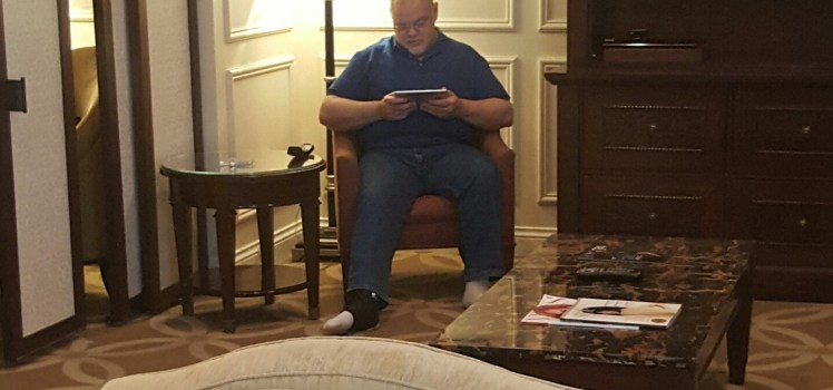 This is Ken sitting in the living room, doing what he does best -- reading news on his iPad.