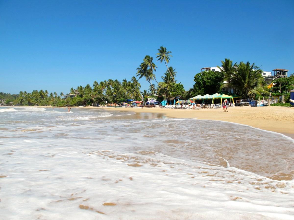 Carefree Mirissa beach in Sri Lanka
