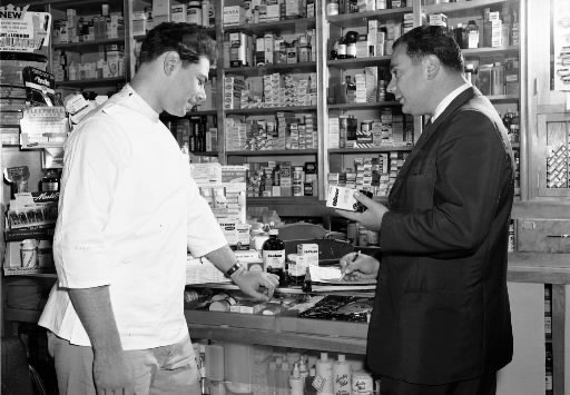 From the pfizer photo archives a sales rep detailing at a pharmacy
