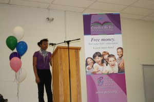 """Naomi speaking to a crowd about the """"right to education"""" as PCYI launched our Enrolled by 6 Strategy"""