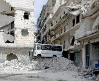 In the Salaheddin district, which is only 50% under government control, streets are blocked off with rubble and a bus. Aleppo, Syria, March 2016.