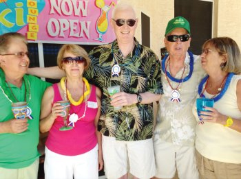 Le Cercle Français members enjoy the Tacky Tiki Bar on March 17, 2015. From left: Dino Cervigini, Lilli Paul, Al Crosson, Robert Risden and Claire Gillet