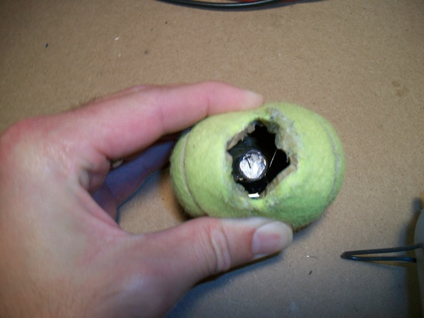 magnet glued inside tennis ball