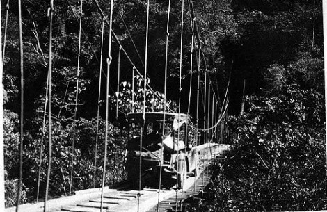 """Automobile crossing rope bridge. 1923."" Photograph made accessible by the Field Museum Library. http://www.flickr.com/photos/field_museum_library/4462494439/"