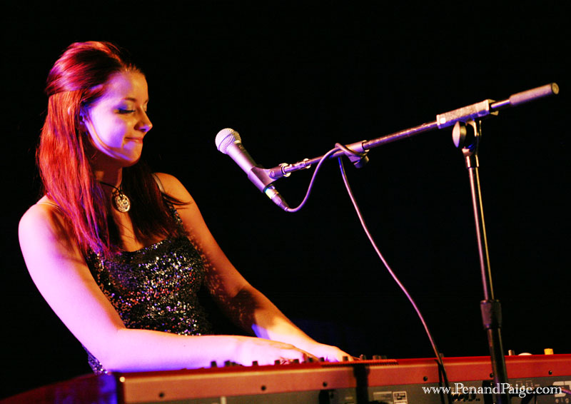 "Hana Pestle at the keyboard smiles as audiences react to her performance of ""Need"" from her debut album, ""This Way."""