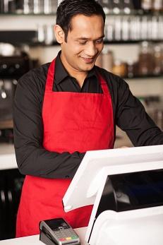 Barista staff placing customers order in queue