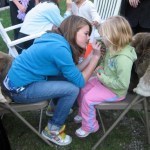 A Girl Scout does face painting as one of the many hike pre-events.