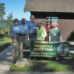 Founding board members stand outside Welcker's Shelter during the 2007 meeting.
