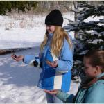 Feeding chickadees at the Nature Center. Photo by Tom Lucas.