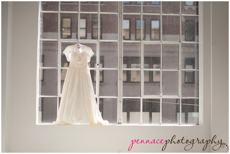 Wedding Gown Hanging Up by Window