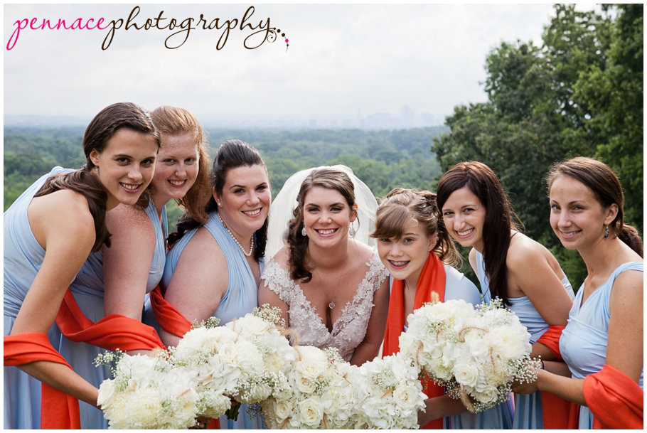 Bridesmaids and brides with bouquets