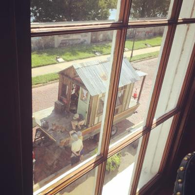 Shantyboat seen through the windows of the Founder's Room at the River Discovery Center in Paducah where the Secret History installation will be for the next two weeks