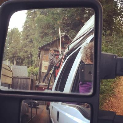 Shantyboat home in Felton California. Benzy has to lift the telephone wires on the little road up to where the shantyboat nestles in the redwoods