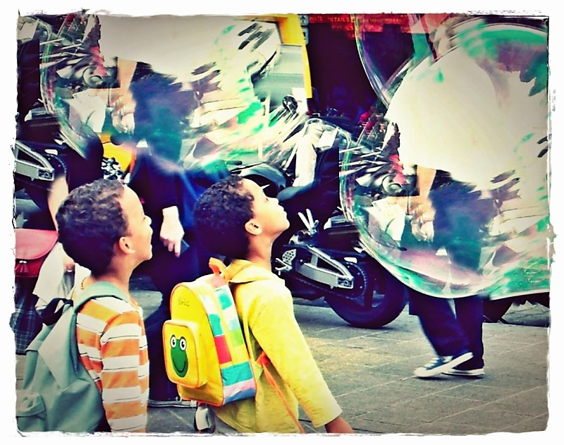 Children seeing large bubbles for the first time in Paris, France.