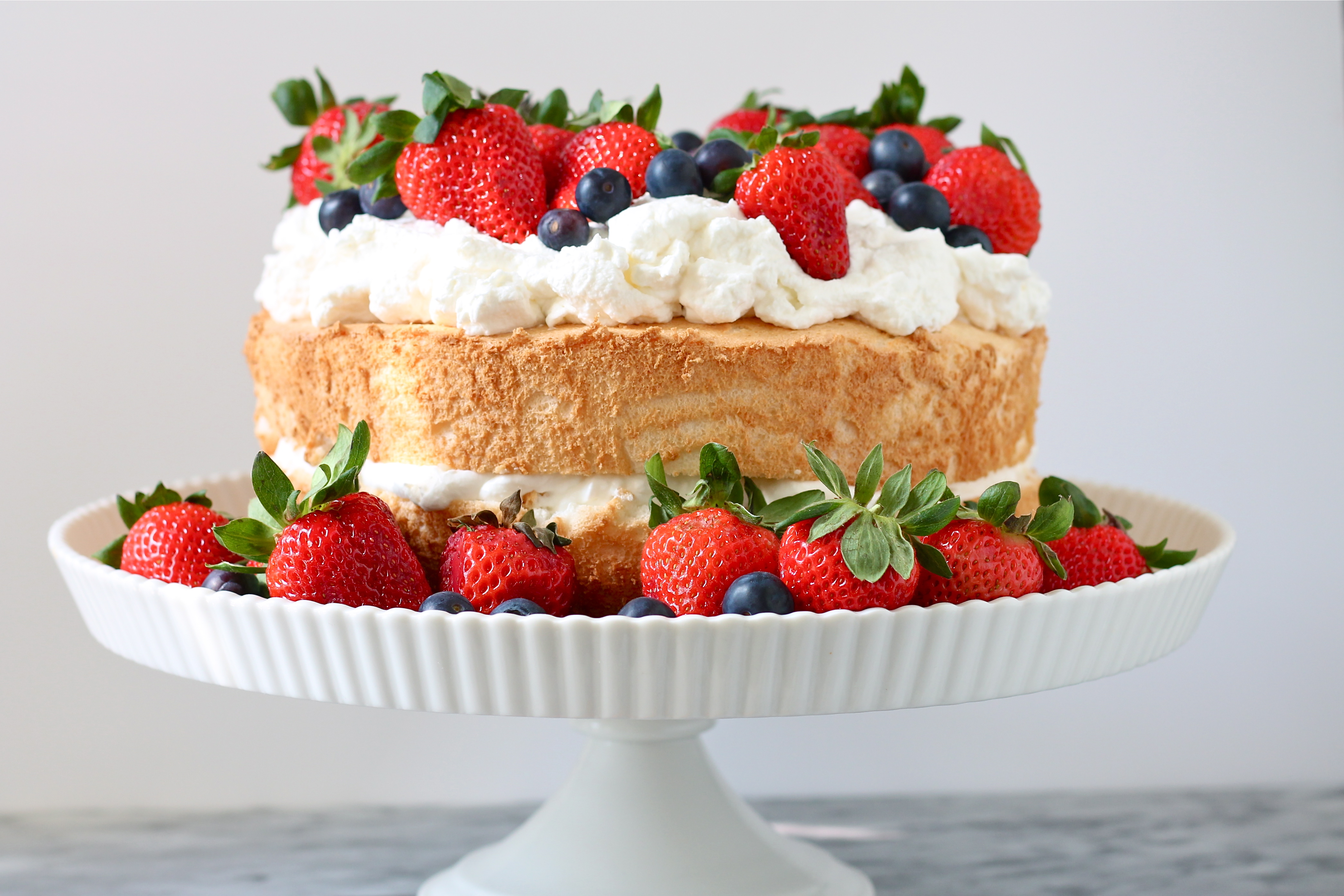 Angel Food Cake with Grand Marnier Whipped Cream | Perpetually Hungry
