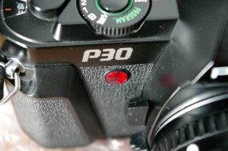 Pentax P30 has shutter speeds from 1/1000 of a second to 1 second. The automatic mode on this film camera chooses the best shutter speed and aperture setting.