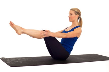 Modified Boat yoga pose to strengthen abs.