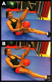 Woman works abs out in figure 8 with ball.