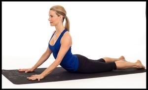 Woman practicing cobra pose.
