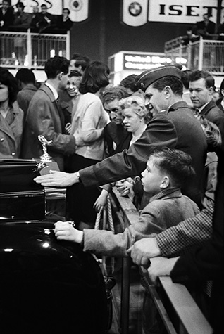 GB. At a motor show, visitors pay homage to a Rolls Royce, priced beyond their wildest dreams. 1959.