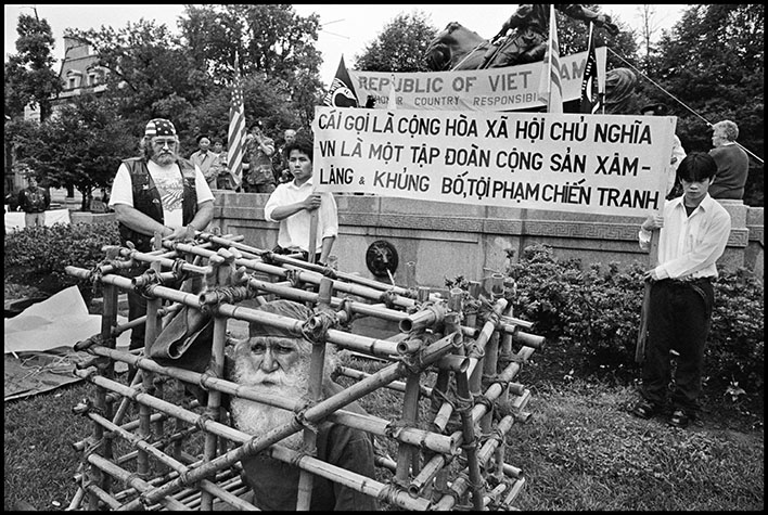 Memorial Day Weekend in Washington D.C where anti-Vietnam motorcycle gangs parade. Here a man is presented in a bamboo
