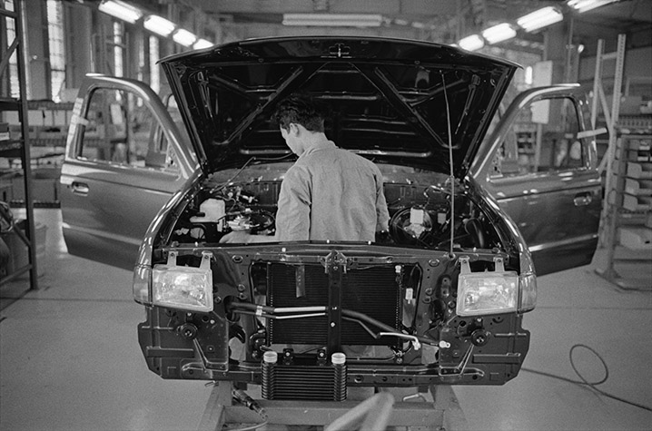 VIETNAM. Vietnam at Peace. Worker at the Ford car factory, a joint venture that was set up in 1995. Sales are 'sluggish' but today's low figure of 5.5 cars per 1,000 people enables manufacturers to be optimistic about the future. 2002.