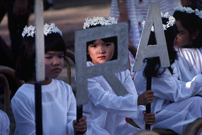PHILIPPINES. Religion in the Philippines. Young children during a religious procession. 1981.