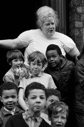 GB. England. Liverpool children. The area known as Liverpool 8 was a thriving artistic community where painters and poets intermingled with real people. Much of their work reflected life around them. The children, before TV, spent most of their time playing outside. 1966.