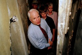 Senator John McCain and his wife and son visit his old cell in the 'Hanoi Hilton' prison in Hanoi