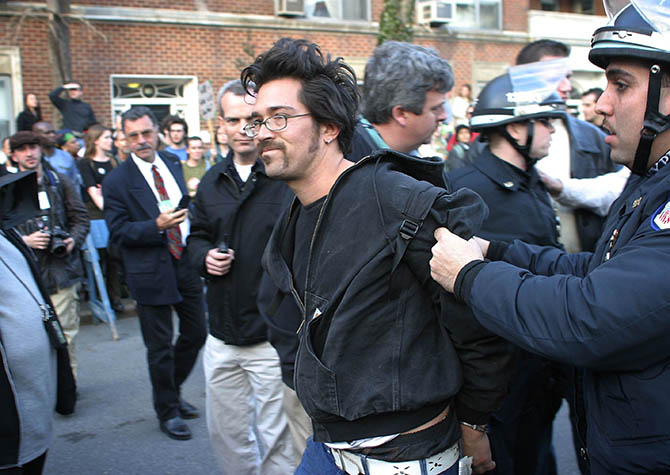 USA. New York City. March 22, 2003. Demonstration against war in Iraq. A demonstrator gets arrested as protestors march down Broadway to Washington Square Park.