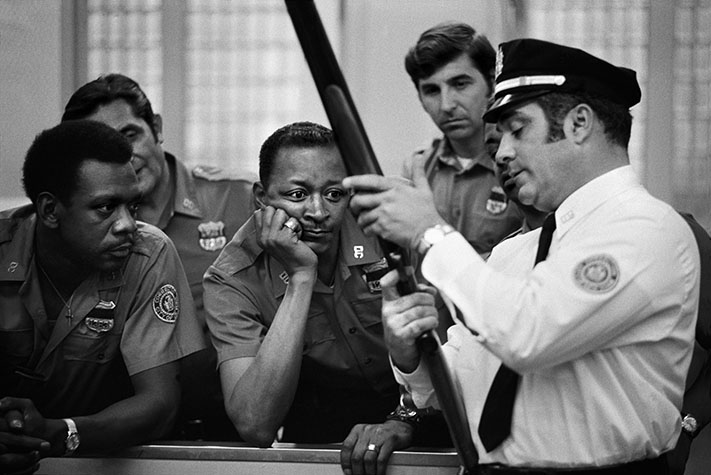 USA. NEW YORK. The people of America love guns and the police are no exception. Here, they are being instructed in the use of the shotgun for