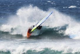 Phil Soltysiak CAN 9 windsurfing spray at Ho'okipa - photo by Lawrence Stewart.