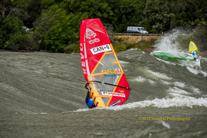 Phil Soltysiak windsurfing. Not bad swells for a river on the Columbia River. Photo by Bob Stawicki.