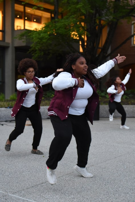 """Justice Robinson '18 throws her hands up in a performance to """"All Day"""" by Kanye West. (L. Hamann/The Phillipian)"""