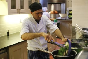 Miguel Agulio prepares a dish at the stir fry station.