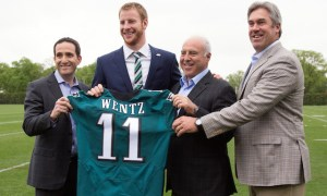 Apr 29, 2016; Philadelphia, PA, USA; From right to left Philadelphia Eagles head coach Doug Pederson and owner Jeffrey Lurie and quarterback Carson Wentz and vice president of football operations Howie Roseman pose for a photo as Wentz is introduced to the media at NovaCare Complex Auditorium. Mandatory Credit: Bill Streicher-USA TODAY Sports