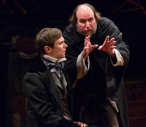 Josh Carpenter as Pip and Brian McCann as Magwitch in Arden Theatre Company's production of GREAT EXPECTATIONS. Photo by Mark Garvin.