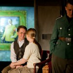 The innocent Bonhoeffer (Chase Byrd) holding hands with his naïve fiancée (Anna Lou Hearn) with Klopstock (Adam Hammet) on duty, but not interfering. Photo by  © James Jackson.