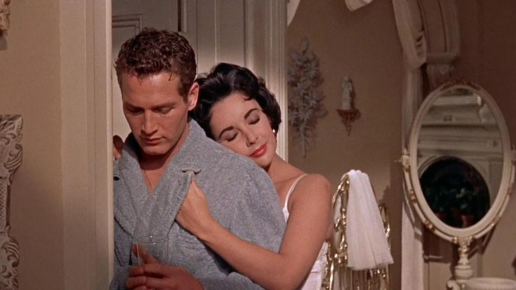 Paul Newman and Elizabeth Taylor in the 1958 film adaptation of CAT ON A HOT TIN ROOF.