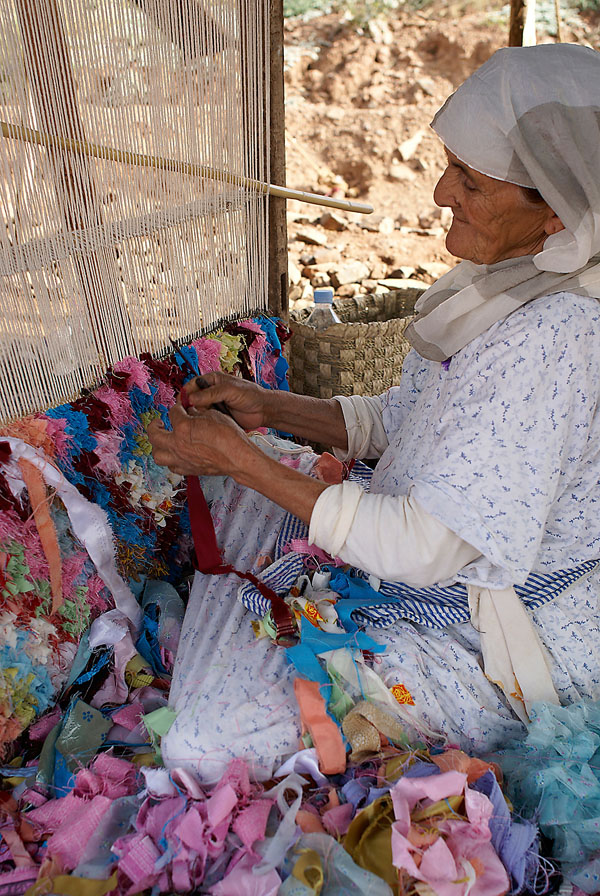 Berber woman making rug