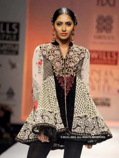 A model showcases a creation by fashion designers Ashish ...