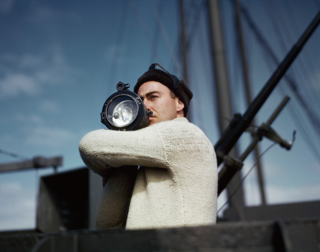 15. Capa_A crewman signals another ship of an Allied convoy across the Atlantic from the U.S. to England