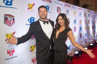 Hosts Brian Stann and Nicole Dabeau arrive at the 2014 Fighters Only World Mixed Martial Arts Awards on Friday, Feb. 7, 2014, at the Venetian.