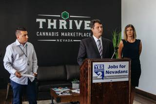 Joe Brezny speaks during a media conference at Thrive Medical Marijuana Dispensary in North Las Vegas on September 8, 2016. On the left is Gustavo Darthenay and right stands Amanda Conner..
