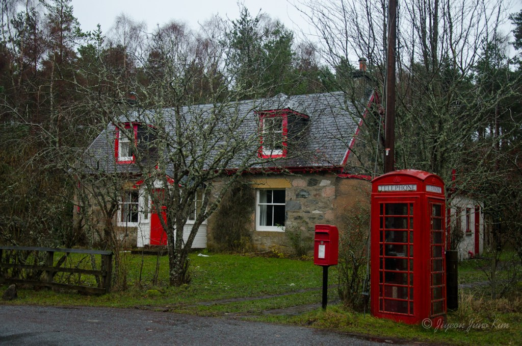 Stone house with a red phone booth