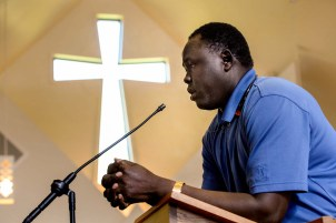 Atem Alue at the memorial service for 36-year-old Philip Aguto. He and Aguto were Lost Boys of Sudan. Scott Sommerdorf/The Salt Lake Tribune
