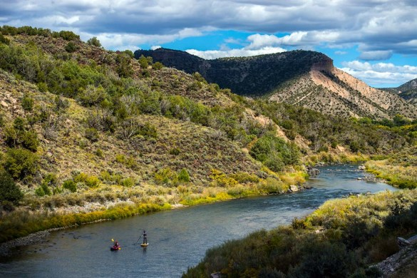 Kim Chatfield, right, and Mia Jennings, stand up paddle board and kayak on the Rio Grande Gorge near Pilar